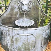 fountains-traditional-lion-and-shell-floor-fountain-with-half-round-cistern